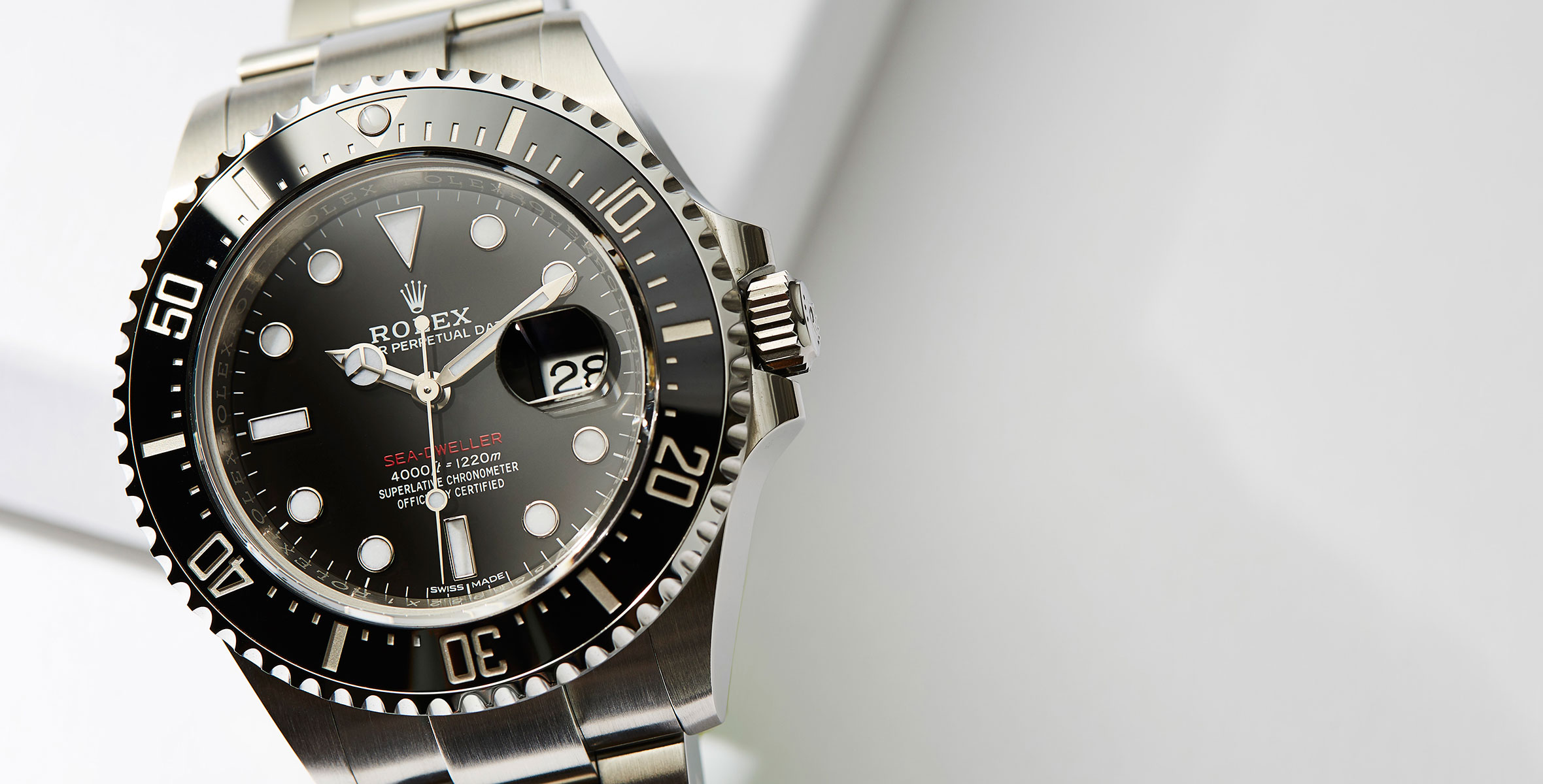 The 43 mm replica Rolex Sea-Dweller 126600 watches have black dials.