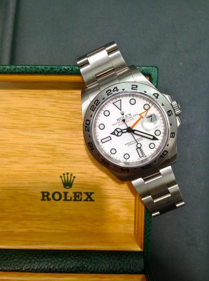 The Oystersteel copy Rolex Explorer II 216570 watches have white dials.
